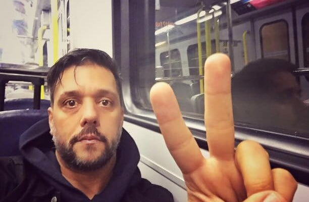 Spotted: George Strombo Takes A Selfie On The Skytrain