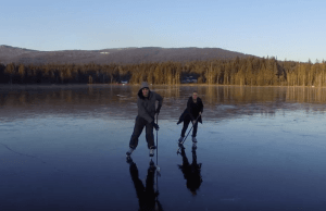 Surreal Drone Footage Captures Hockey Game On Frozen Lake Near Maple Ridge