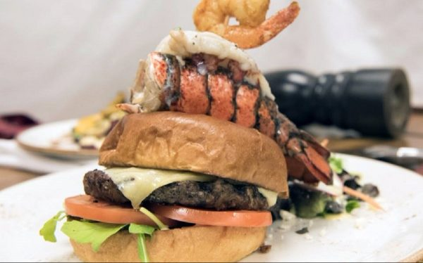 burger topped with lobster