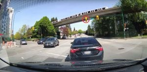 Driver In Burnaby Makes a Terrible Left Turn On a Clear Red Light (VIDEO)