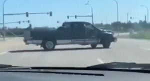 3-Wheeled Pickup Does Donut On Highway, Driver-Police Foot-Chase Ensues