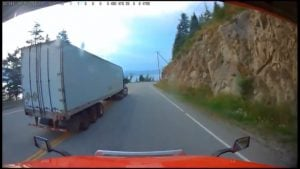 Semi- Truck Passes On Trans Canada Highway, Nearly Misses Oncoming Car (Video)