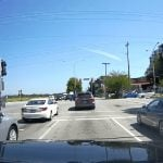 Dashcam Footage Shows Van Proceeding On Red Light, Nearly Hits a Car (VIDEO)