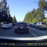 Truck Drives Over Center Median In a Rush To Turn Left (VIDEO)